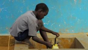 Boy stocks drinking water in Kenya