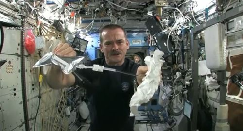 Chris Hadfield Wringing Out Washcloth in Space